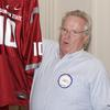 Washington States greatest fan, David DeMeyer, with a prized posession, a WSU jersey.