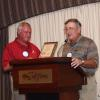 President John McCormick presents a plaque to past President, Fred Dickinson.